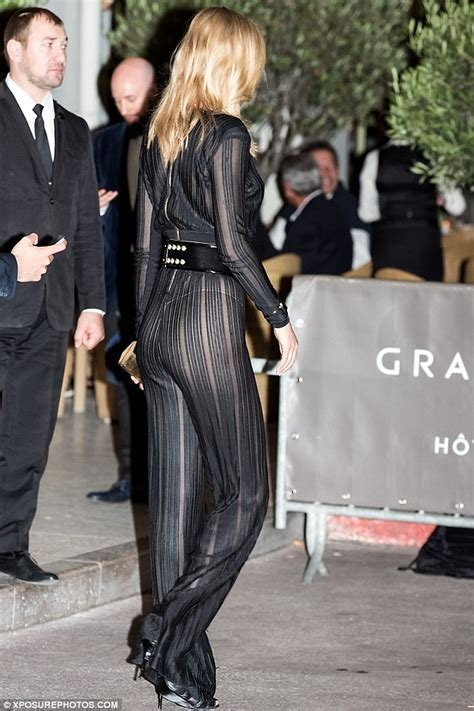 Toni Garrn flashes her underwear in jumpsuit for Cannes