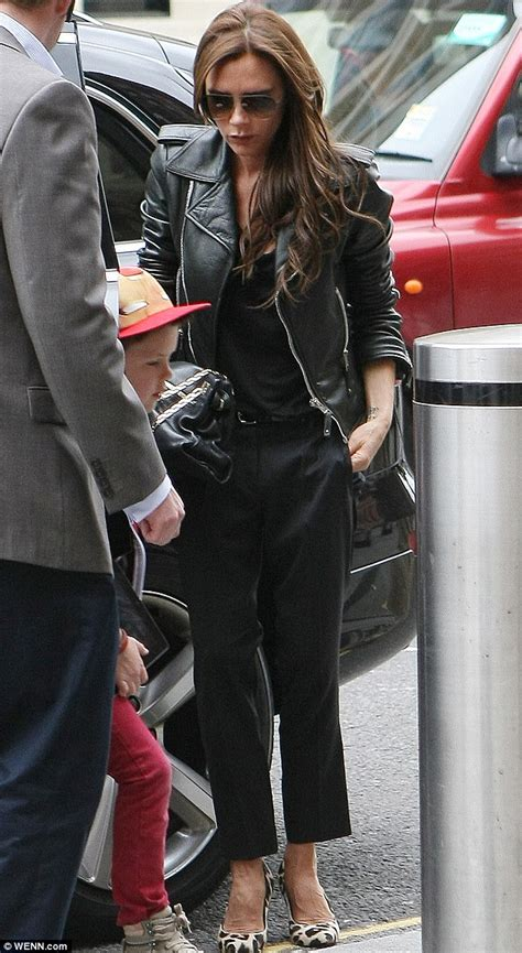Victoria Beckham leads the way as the Beckhams head to